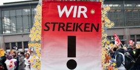 Schild mit der Aufschrift: Wir Streiken!